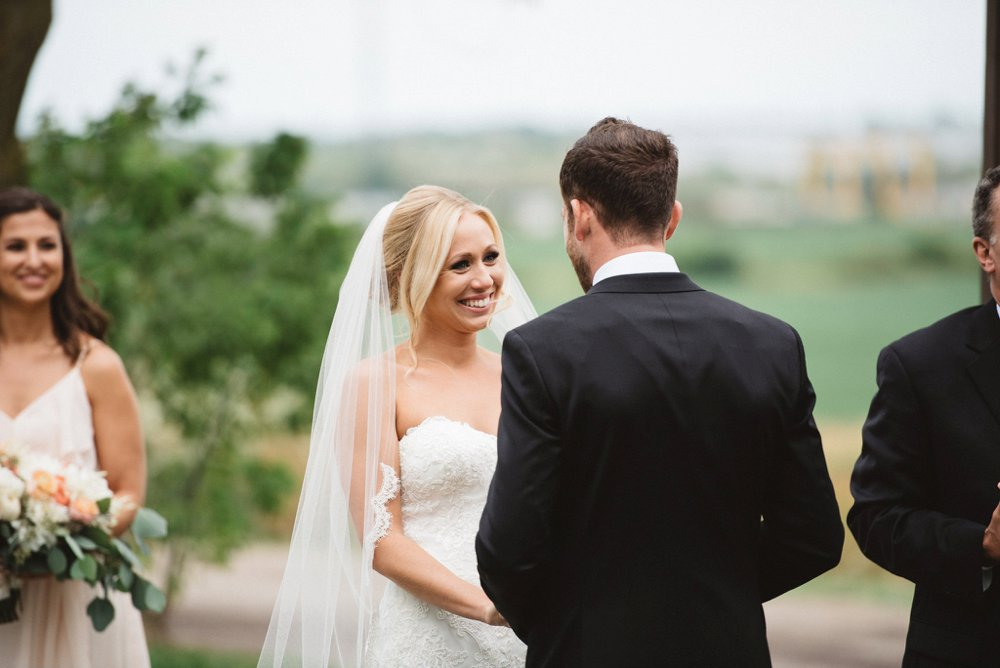 Bride at Ceremony - Olive Photography
