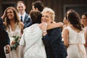 Mothers Hugging at Wedding - Olive Photography